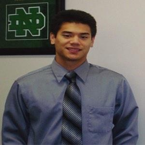 2013 scholarship winner Matthew McCreary in a grey shirt with tie