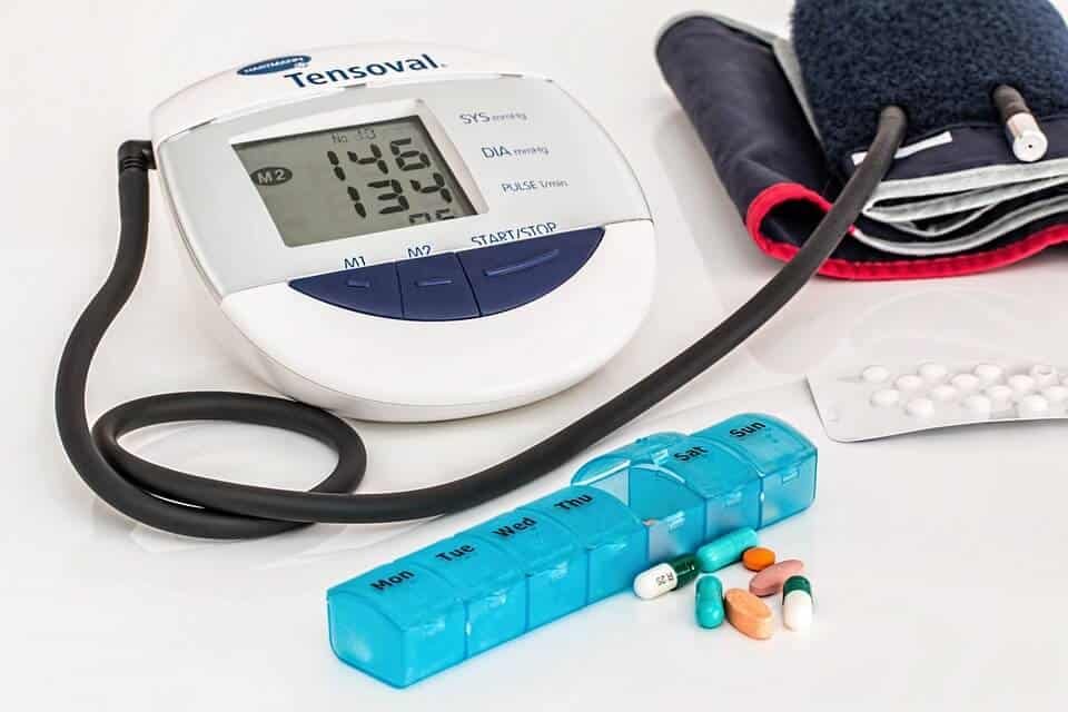 Blood pressure machine with pills and pill travel case