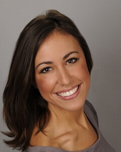Headshot of Ms. Elizabath Biscevic, she has silky dark brown hair
