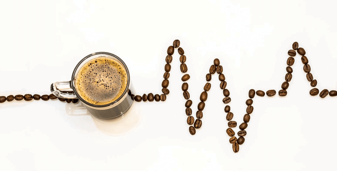 Cup of coffee, with a trail of coffee beans lined up depicting a heart rate