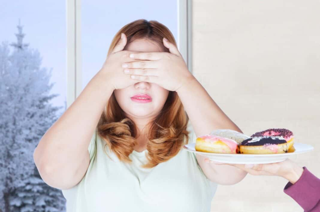 Look away from food to stop mindless eating.