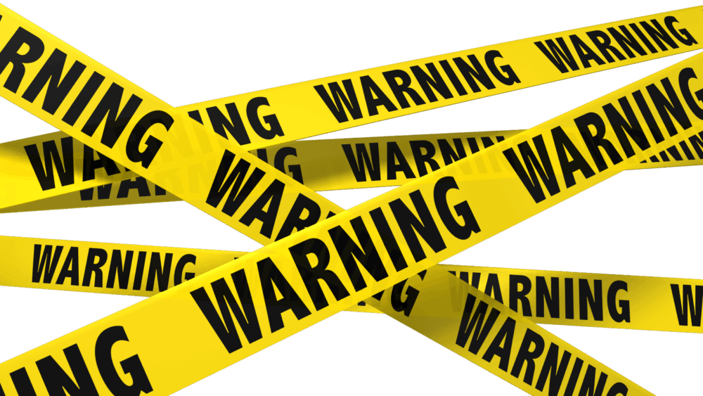 "Yellow tape across entire image with black lettering that reads ""Warning"""